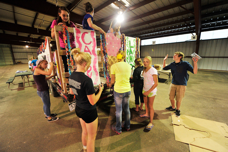 Walt Hester | Trail Gazette<br /> Members of the Estes Park High School's sophomore class assembles their homecoming float on Monday. The students will ride their float during Thursday's parade.