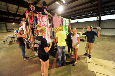 Walt Hester | Trail Gazette Members of the Estes Park High School's sophomore class assembles their homecoming float on Monday. The students will ride their float during Thursday's parade.