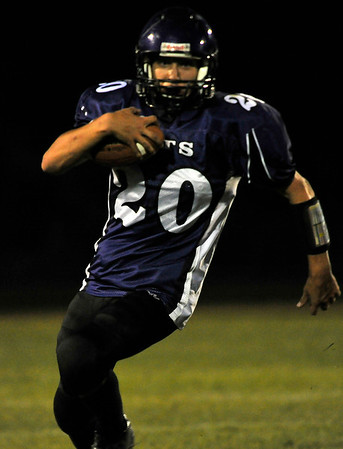 Walt Hester | Trail Gazette<br /> Kayle Robidart turns the corner in the first quarter against Lyons on Friday. Robidart had some success on the ground and showed off a little speed on returns.