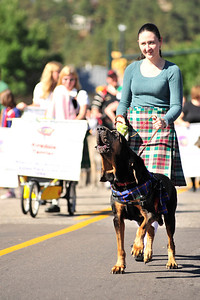 Walt Hester | Trail Gazette Morgan Kols of Berthoud walks her singing bloodhound, Vernon, during Saturday's parade. The parade featured many dogs of the British Isles.
