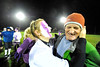 Walt Hester | Trail Gazette<br /> Jesse O'Dell plants a wet and paint-smeared kiss on Rick, her father's, cheek on Wednesday. The Homecoming week tradition, the Powder Puff Game, was played in a chilly, soaking rain, and ended with a Seniors win, 37-7.