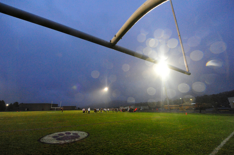 Walt Hester | Trail Gazette<br /> Rain was as much the story as the game on Wednesday. Fans and players suffered through cool temperatures and steady rain.