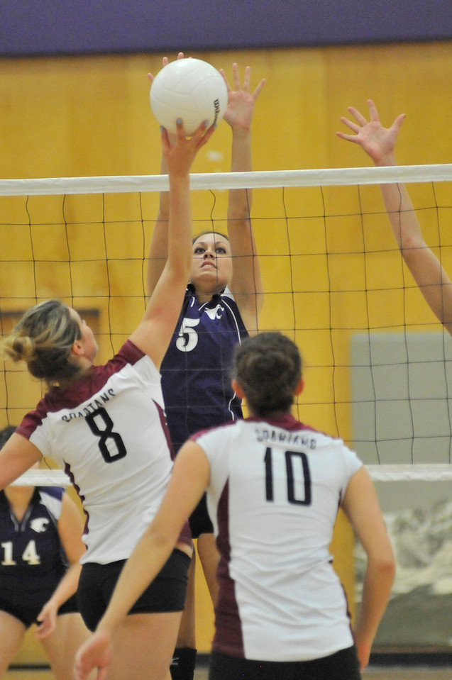 Walt Hester | Trail Gazette<br /> Estes Park's Erin Barker reaches for the block against Berthoud on Tuesday. While the Ladycats grabbed the first game of the match, the Spartans took the next three and the win.