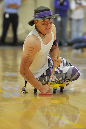 Walt Hester | Trail Gazette<br /> Nate DeWitt plunges his way toward the finish line during Friday's skooter race during the homecoming pep rally. WHile the rusults were questionable, it was all in fun.