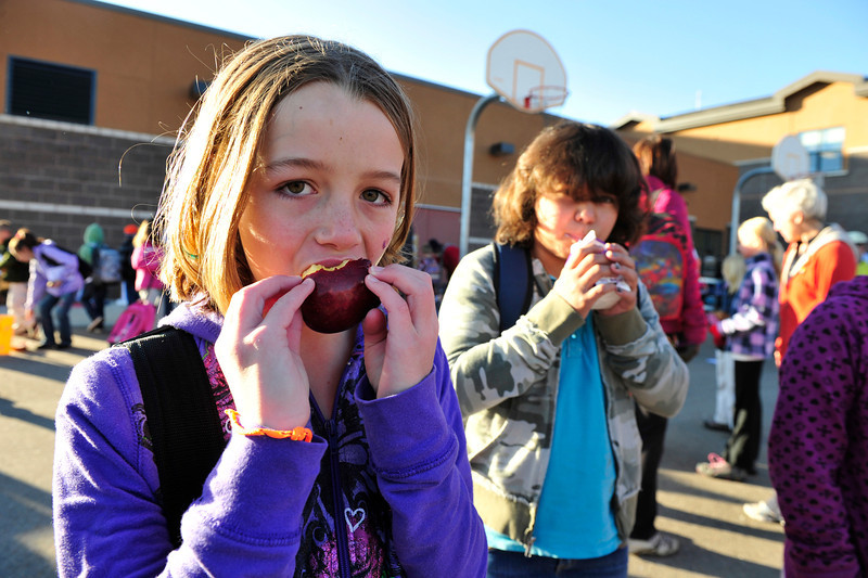 Walt Hester | Trail Gazette<br /> Elementary school students Kaelin Flanery and Jamaiqa Brown, both 10, enjoy a little breakfast at the school on Wednesday. The Estes Park Elementary School celebrated Walk or Ride to School Day on Wednesday, encouraging children and parents to use legs in stead of cars to get to school.