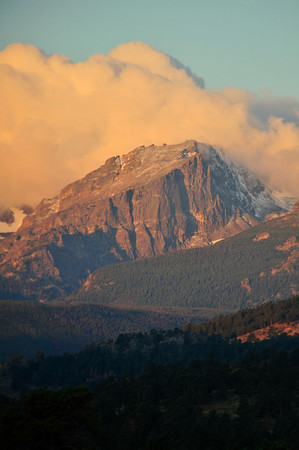 Walt Hester | Trail Gazette<br /> New snow and clouds adorn Hallett Peak on Friday. After a few days of cool temperatures and rain, the weekend saw harmer temperatures, but signs of fall, none the less.