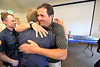 Walt Hester | Trail Gazette<br /> Robert Schumaker hugs fire chief Scott Dorman at the farewell event at the Estes Park Museum on Monday. Schumaker leaves the force after 20 years of service to Estes Park.