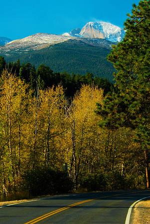 Walt Hester | Trail-Gazette<br /> Aspens line Bear Lake Road as the snow-capped Longs Peak towers in the distance. Estes Park's Autumn Gold Festival begins Saturday morning in Bond Park