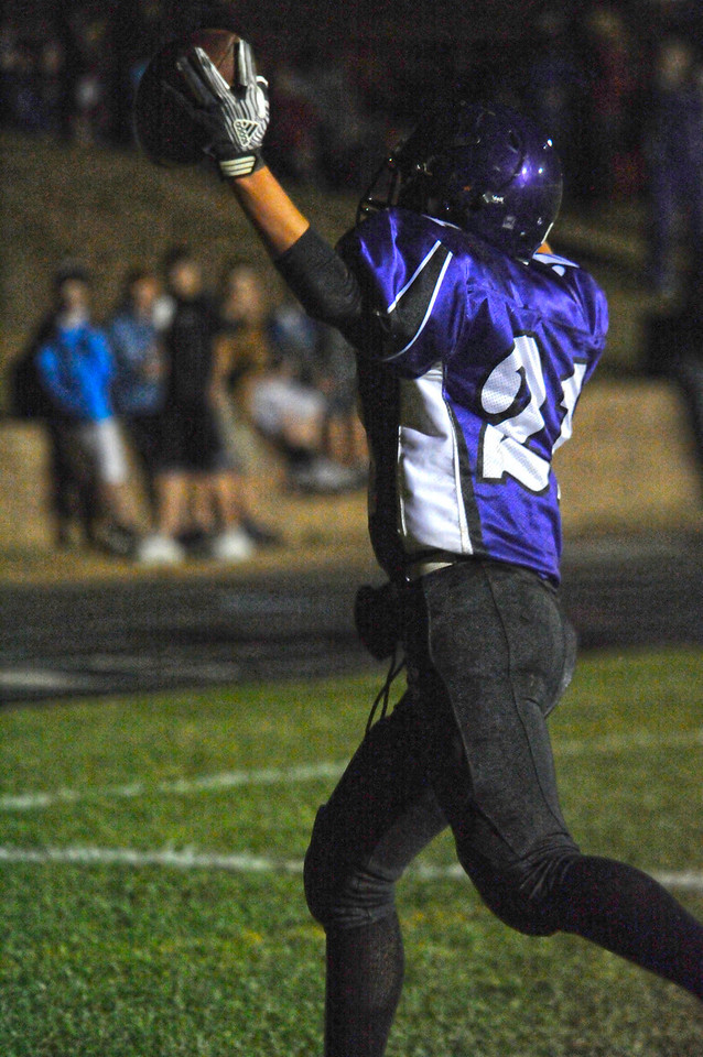 Walt Hester | Trail Gazette<br /> Estes Park's Kieth Trahan celebrates the second-quarter touchdown against the Eaton Reds on Friday. While the 19-yard pass play seemed to bode well for the 'Cats, they were only able to must one more score, losing to the Reds 55-13.