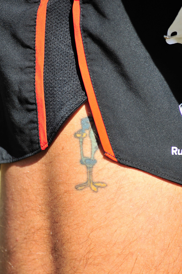 Walt Hester | Trail Gazette<br /> A Roadrunner tattoo peeks out of the shorts of runner Mark Saunders of Fort Collins. Saunders is a past winner of the ROB, and was the runner-up on Saturday.