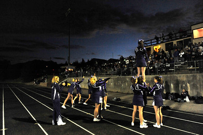 Walt Hester | Trail Gazette The Estes Park High School cheerleaders entertain football fans during a stoppage in play due to the southwest stadium lights outage. Play resumed, the lights came back on only to blink out again.