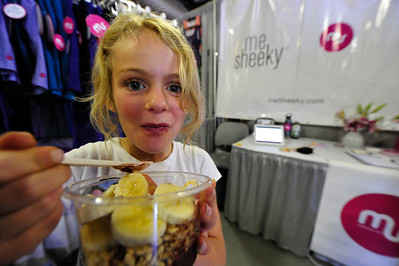 Walt Hester | Trail Gazette Emma Hever, 8, of San Diego enjoys some acai berry sorbet with bananas and granola at the Yoga Journal Conference Marketplace on Sunday. The annual conference ran last week through Sunday at the YMCA of the Rockies.