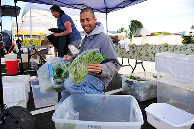 Walt Hester | Trail Gazette Phillip Smith of Loveland's Eden Valley Farms packs up at the end of Thursday's Estes Valley Farmers' Market. This Thursday will bethe last market of the season.