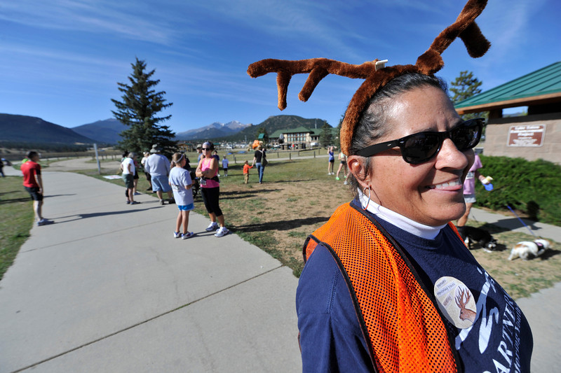 Walt Hester | Trail Gazette<br /> Volunteers have a little fun with the elk theme of the run on Saturday. Novalty antlers were the only head gear needed on the warm fall day.