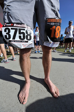 Walt Hester   Trail Gazette<br /> Local barefoot runner Alan Smith couldn't wait for the 10 am start time of the Running of the Bulls, so he ran the Sambrero Ranch Trail Run first. Smith raced a total of 7 miles before 11 am.