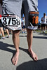 Walt Hester | Trail Gazette<br /> Local barefoot runner Alan Smith couldn't wait for the 10 am start time of the Running of the Bulls, so he ran the Sambrero Ranch Trail Run first. Smith raced a total of 7 miles before 11 am.
