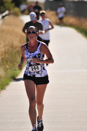 Walt Hester | Trail Gazette<br /> Amy Hayden of Loveland leads runners up the final climb of the Running of the Bulls on Saturday.