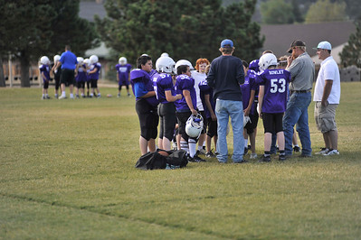 Walt Hester | Trail Gazette The Estes Park Elementary School's football teams hudle before drills on Tuesday. The teams are the future of Bobcats' football.