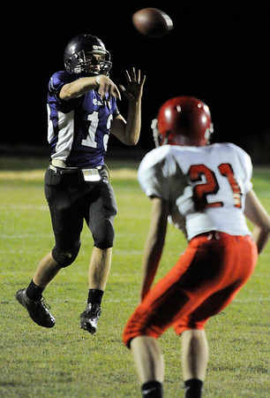 Walt Hester   Trail Gazette<br /> Frankie KellerTwigg throws a second-quarter touchdown on Friday against the Eaton Reds. Keller-Twigg had a hand in both Bobcats' scores, including a one-yard plunge in the final minute of the game.