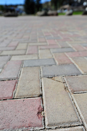 Walt Hester | Trail Gazette<br /> Paving stones on MacGregor Avenue show wear and tear on Wednesday. The pavers were installed last spring.