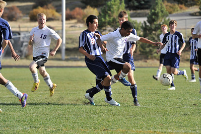 Walt Hester | Trail Gazette Jose Marquez fights through against Frontier Academy on Monday. Marquez was one of five different scorers in the Bobcats' 5-0 win over Community Christian on Tuesday.