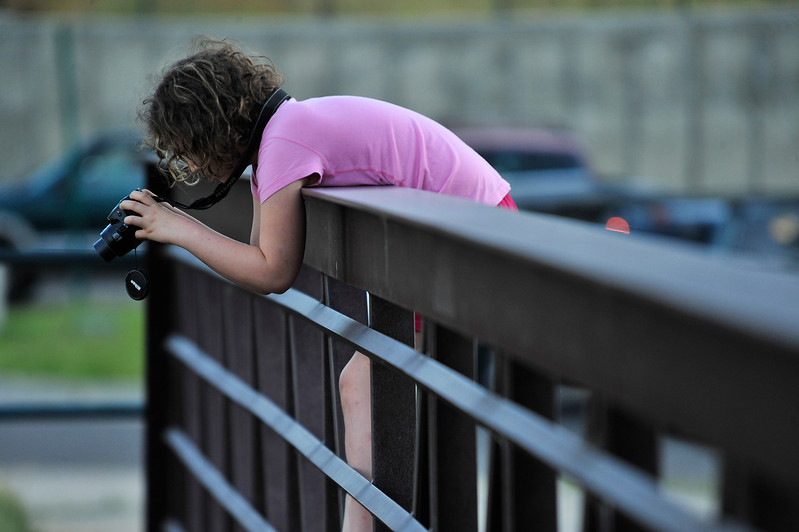 Walt Hester | Trail Gazette<br /> Abigal Elliot of Estes Park attempts to photograph the leaping trout at the cascade along the Big Thompson River on Tuesday. The young photographer has received recognition for her work in the past.