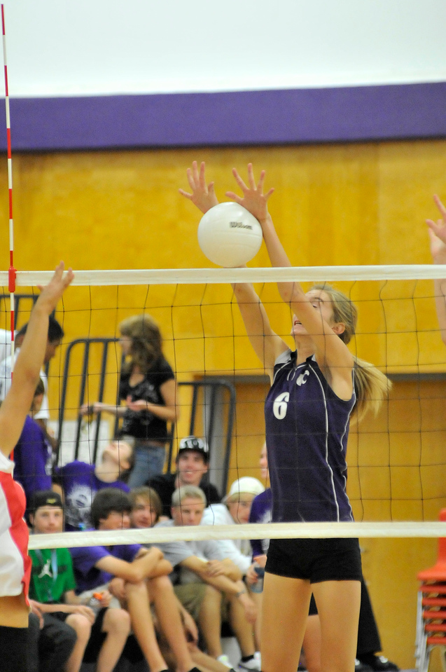 "Walt Hester | Trail Gazette<br /> Estes Park's Evelyn Bangs blocks a hit against Denver School of Science and Technology on Monday. The 6'2"" Ladycat has enjoyed some success blocking for the vollyball team this season."