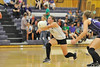 Walt Hester | Trail Gazette<br /> Audrey Ault digs out a hit against DSST on Monday. Ault had 21 digs in the Ladycats' Tuesday night match against Mead.