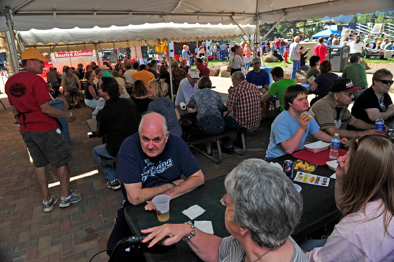 Walt Hester | Trail Gazette<br /> Visitors enjoy beer, brats and live music in Bond Park this Sunday. The annual Autumn Gold festival highlighted the many event in a busy weekend in Estes Park.