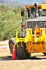 Walt Hester | Trail Gazette<br /> A driver backs his road grader around cones at the annual Western Snow and Ice Show and Rodeo on Wednesday. Drivers are timed while menuvering around barriers and scooping tennis balls set at different heights.