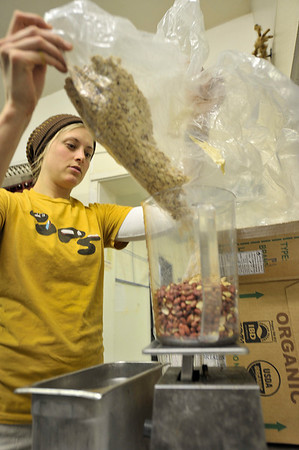 Walt Hester | Trail-Gazette<br /> Wieser measures out organic peanuts for her peanut butter. Wieser uses as many organic and fair-trade ingredients as she can in her nut butters.