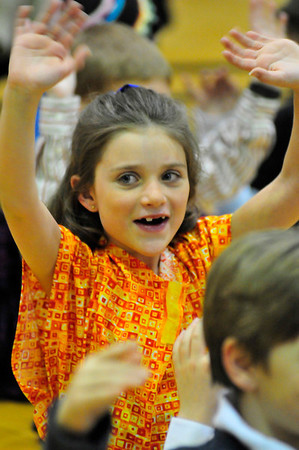 Walt Hester | Trail Gazette<br /> Keagan Glassman ports bright colors as she sings during the Estes Park Elementary School's annual Africa Night on Tuesday. The school's third grade studies Africa's history, cultures and animals, then presents what they have learned for friends and families.