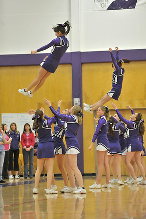 Walt Hester | Trail-Gazette<br /> Flyers of the Estes Park High School's cheerleaders descend into the waiting arms of team mates during a performance on Friday.