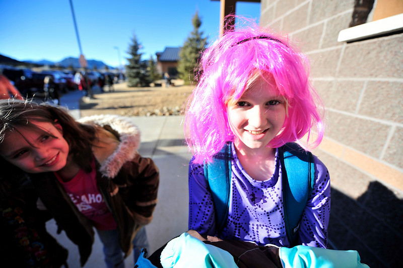 "Walt Hester | Trail-Gazette<br /> Estes Park third-grader Kylie Jackson sports shocking pink hair at the elementary school on Friday. The school celebrated ""Crazy Hair Day."""