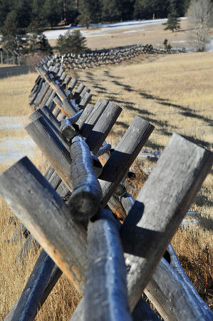 Walt Hester | Trail Gazette<br /> Frost glistens on a buck and rail fence along Devils Gulch Road on Wednesday. The fence defines the edge of MacGregor Ranch.