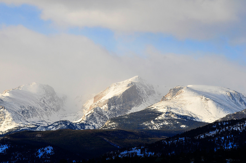 Walt Hester | Trail-Gazette<br /> Clouds clear enough as the sun rises over Estes Park on Monday. More snow could visit Estes Park through the week.