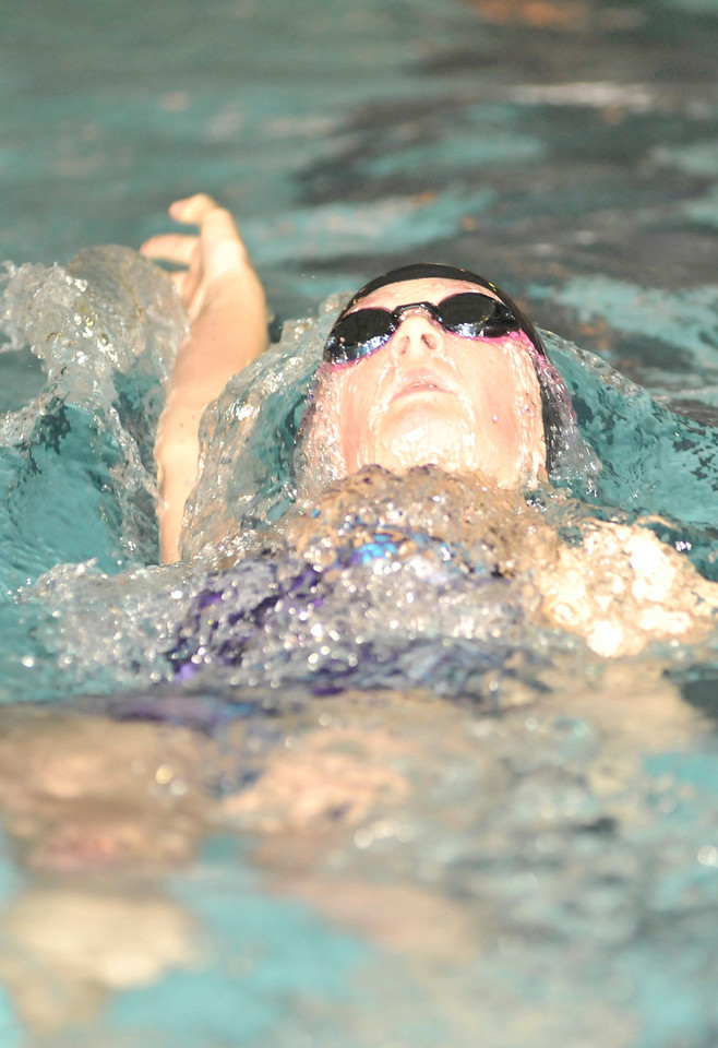 Walt Hester | Trail-Gazette<br /> Emily Franklin swims the backstroke against Sterling on Thursday. The Ladycats overpowered a small Sterling squad, 146-31.