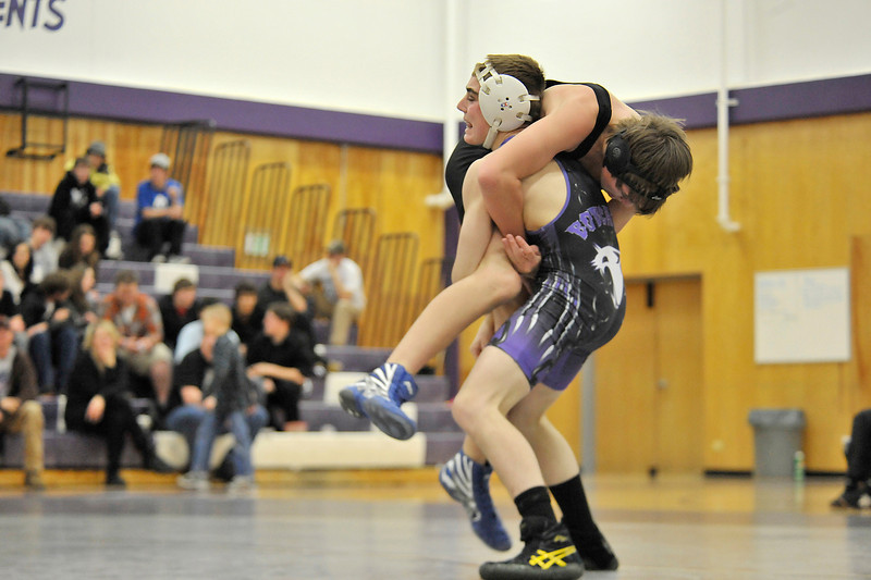 Walt Hester   Trail-Gazette<br /> Will Casey picks up and takes down Kelton Tschanz of Lyons during an exibition match on Thursday. Casey received a forfiet for his 112-pound match.