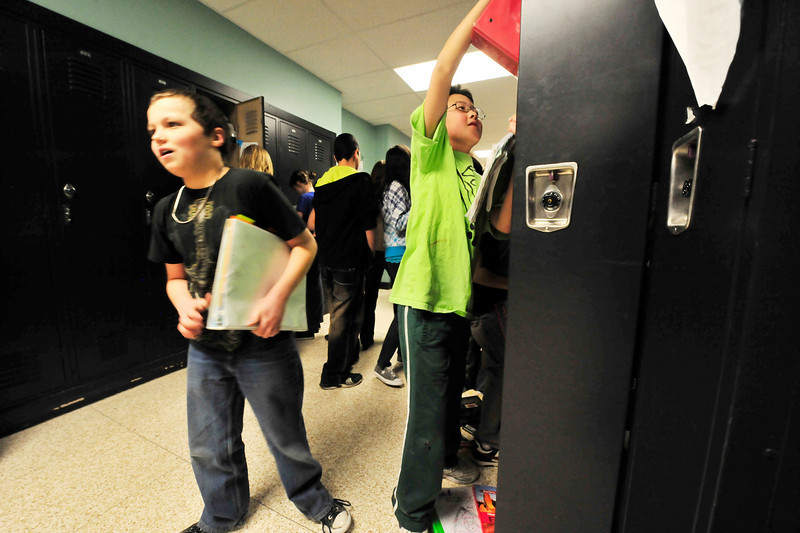 Walt Hester | Trail-Gazette<br /> Josh Palmer, left, and Noah Bielmaier, both 11, hurry to get books and get to class at the Estes Park Middle School on Wednesday.