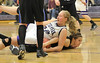 Walt Hester | Trail-Gazette<br /> Annika VanderWerf has the better position over a Lyons player on Tuesday. VanderWerf and the Ladycats tallied their third straight win by downing the Lions, 38-29.