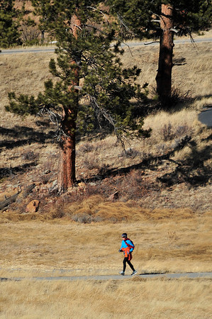 Walt Hester | Trail Gazette<br /> A runner enjoys a workout in the relatively mild temperatures of Wednesday. Friday could see highs in the 50s before temperatures dip and snow returns next week.