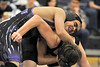 Walt Hester | Trail-Gazette<br /> Bailey Flores turns his opponent from Lyons on Thursday night. Flores won his match in a pin.