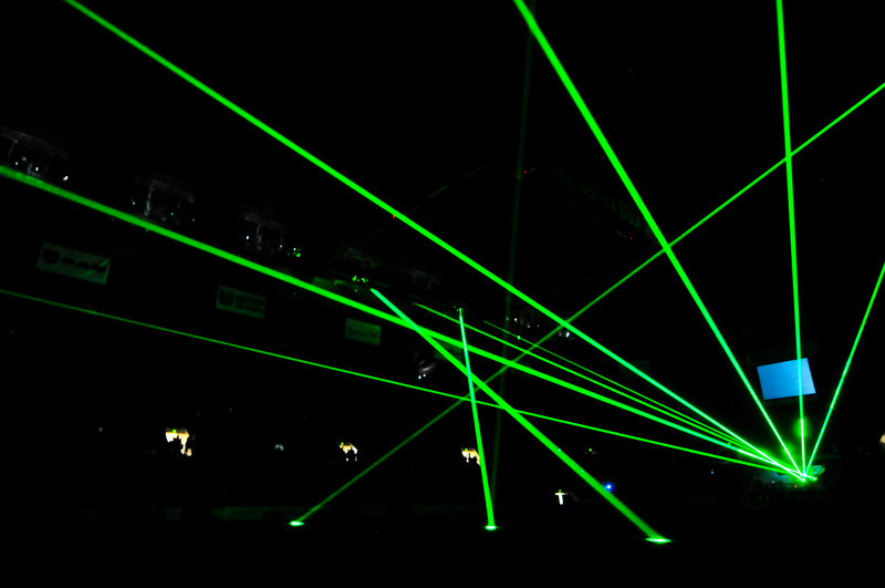 Walt Hester | Trail-Gazette<br /> Lasers pierce the air of the Denver Colusiem before the start of the National Western Stock Show Rodeo on Sunday.