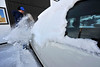 Walt Hester | Trail-Gazette<br /> Jim Ellis sweeps about three inches of snow off of his car on Monday morning. Again, most of this winter snow fell south of Estes Park.