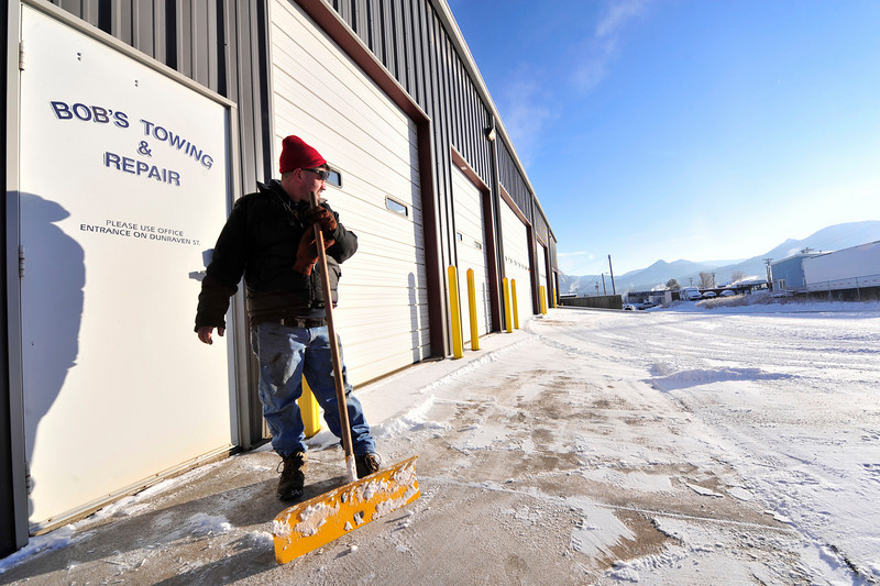 Walt Hester | Trail-Gazette<br /> Daniel Rodfong looks over his work before the real work begins Monday. A weekend storm created dangerous driving from Catsle Rock to Fort Collins and tow trucks were out to pick up the wreckage before 8 a.m. Monday.