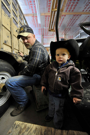 Walt Hester | Trail-Gazette<br /> Brett Rasmussen and son, Hadlee, work on a horse trailer at MacGregor Ranch on Wednesday. The Rasmussen's have three young children, all of whom help on the ranch.