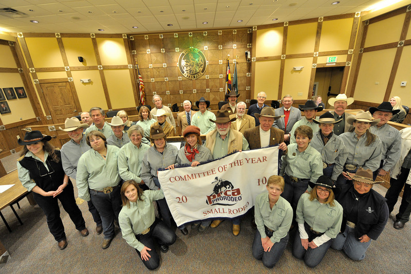 Walt Hester | Trail-Gazette<br /> Rooftop Rodeo Committee members and the town board display the banner declaring the PRCA's Best Small Outdoor Rodeo Committee for 2010 at Tuesday's Town Board meeting. This is the fifth time the Rooftop Rodeo has received the award in the last eight years, and the third year in a row.
