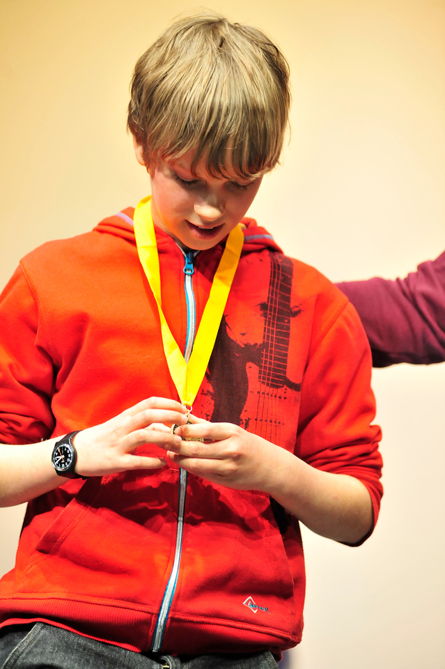 Walt Hester | Trail-Gazette<br /> Brad Harris, 13, admires his gold medal after winning the Estes Park Middle School's National Geographic Geography Bee. Young Mr. Harris will compete in the state geography bee in the spring.