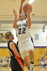 Walt Hester | Trail-Gazette<br /> Zach Eitzen drives for two of his seven points against the Bennett Tigers on Friday. Eitzen lead the Bobcats in scoring with 19 points against Peak to Peak on Saturday in another difficult loss.