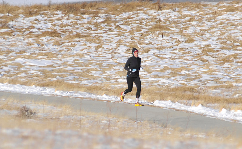 Walt Hester | Trail-Gazette<br /> A runner plods along the trail through Carriage Hills on Wednesday. While the start of the week saw bitter cold, the second half could see 40-degree temperatures, making outdoor activities a bit more comfortable.